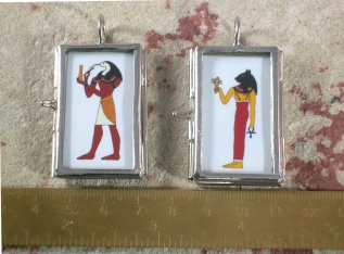 thoth and beast pendants back